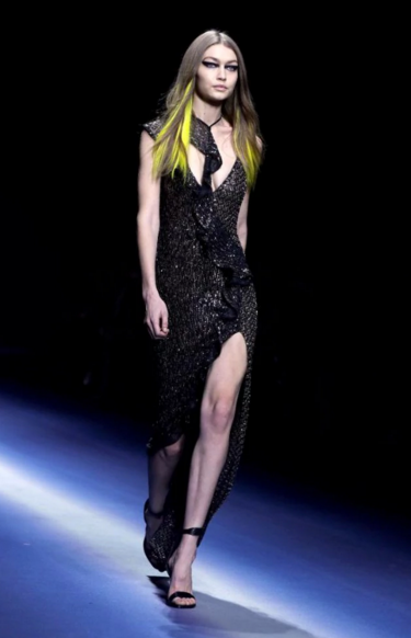 Gigi Hadid showed off the slinky cocktail dresses on display at Versace's AW17 show. CREDIT: AP