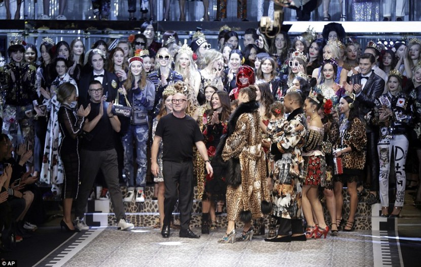 Take a bow: With models surrounding them, Stehano Gabbana, left, and Domenico Dolce, right, stepped out on the catwalk